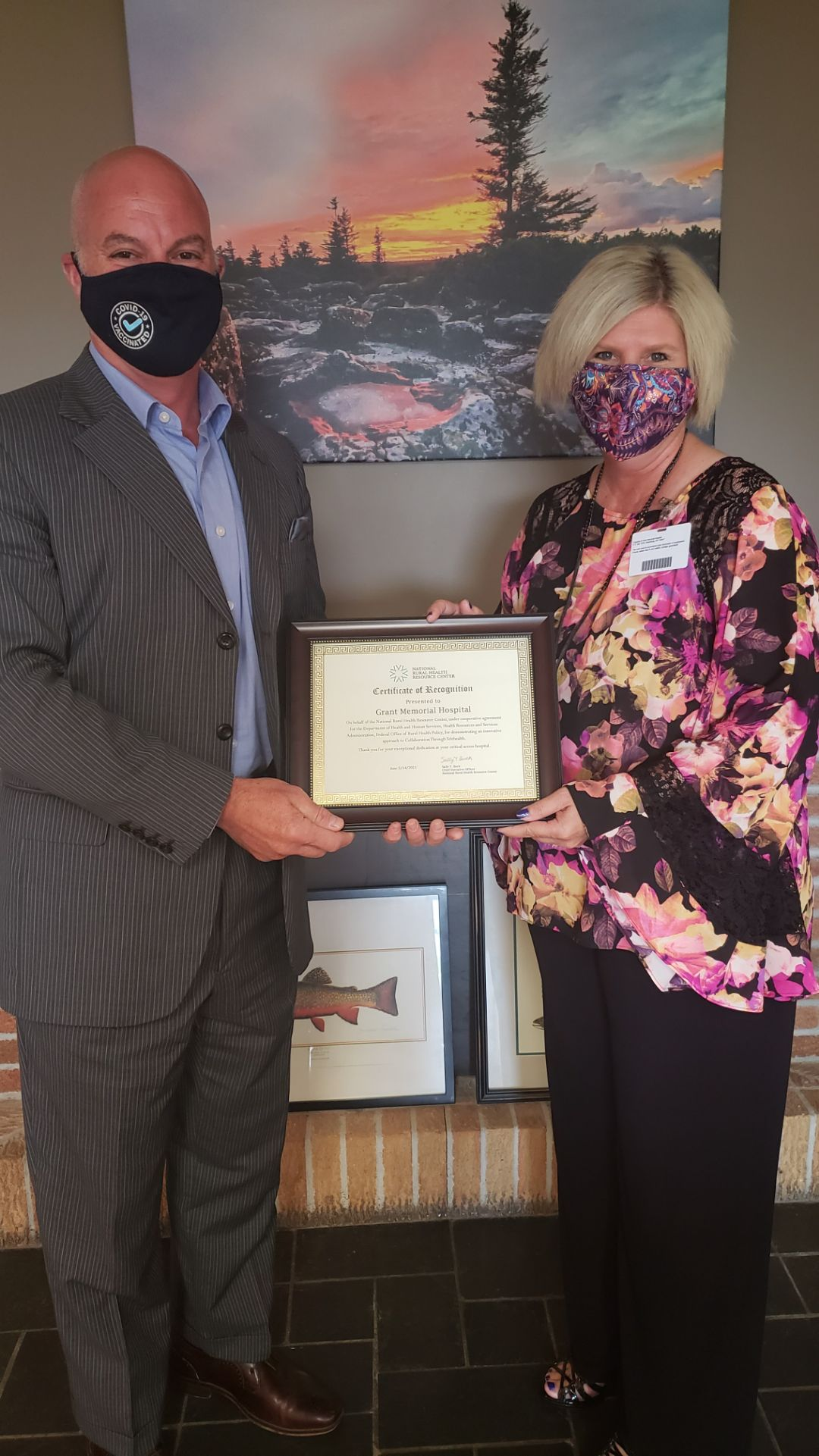 Bob Milvet, CEO, Grant Memorial Hospital accepting recognition certificate from Lisa Lewis, Hospital Programs Manager, West Virginia State Office of Rural Health