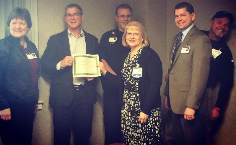 Executives and staff of Tillamook Regional Medical Center accept CAH Recognition Certificate from Oregon Flex Program officer