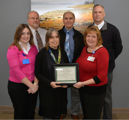 Athol Hospital leaders and community stakeholders accept CAH Recognition Certificate.