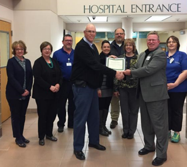 Avera Holy Family Hospital and partners accept CAH Recognition Certificate from the Iowa Flex Program