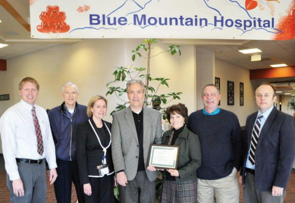 Hospital executives receive CAH Recognition certificate from Utah Flex officers