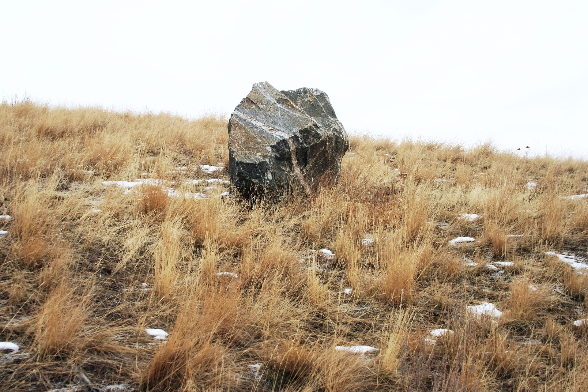 Image of a large rock resting on a hillside