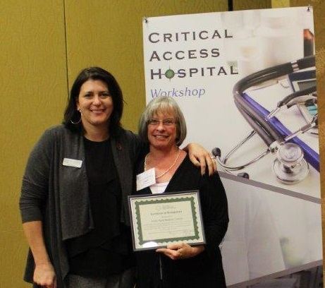 Estes Park Medical Center Quality Director Janet Zeshin receives CAH Recognition certificate from Michelle Mills, Colorado Rural Health Center