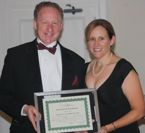 Steven L. Kelley, FACHE, Ellenville Regional Hospital President and CEO receiving award from Karen Madden, State Office of Rural Health Director, New York
