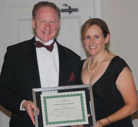 Steven L. Kelley, FACHE, Ellenville Regional Hospital President and CEO receiving award from Karen Madden, State Office Director, New York
