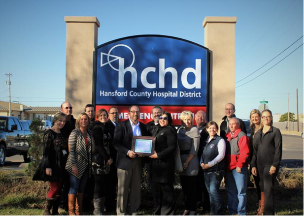 HCHD CEO and staff receive CAH Recognition certificate from Texas Flex Program officer