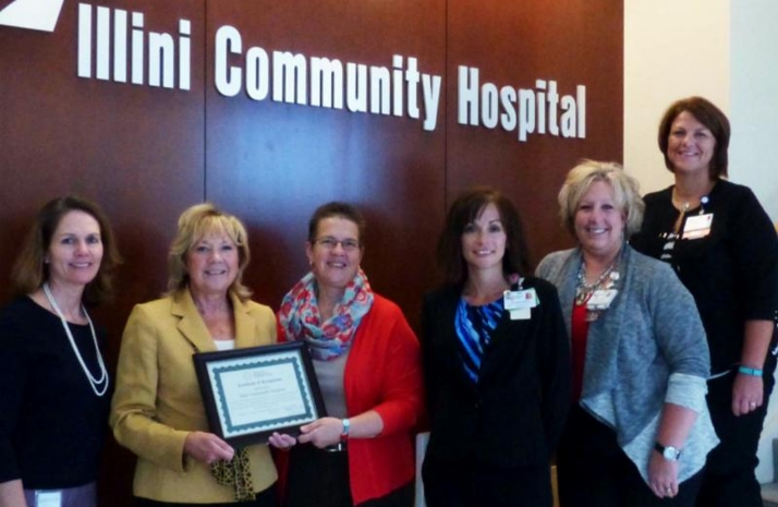 ICH leaders receive CAH Recognition certificate from Illinois Flex officers