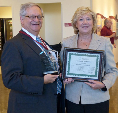 Harry Wolin, CEO, Mason District Hospital, receiving award from Pat Schou, Illinois Flex Program