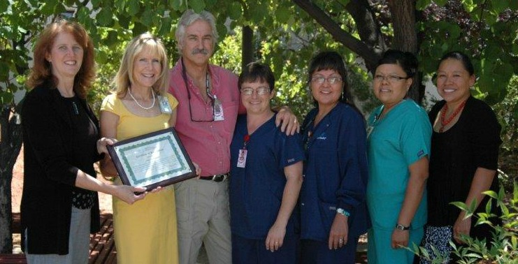 Jill Bullock of the Arizona Flex Program presents a CAH Recognition award to Page hospital staff